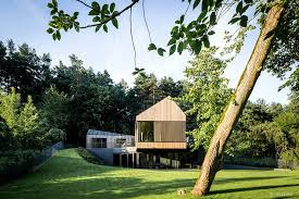 Slope House A Wooden House On A Verdant Slope
