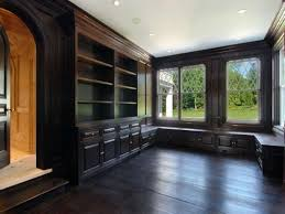 stained wood panels library with dark stained wood floor and paneling an arched ideas