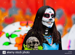 halloween in mexico city a young woman dressed as la catrina a mexican pop culture icon