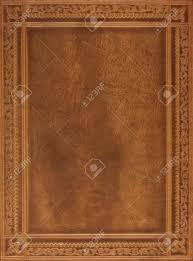 brown leather book or journal cover with a decorative floral