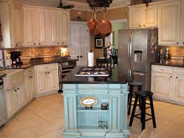 vintage farmhouse table in rustic kitchen with green pendant