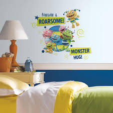 roommates the lion king peel and stick wall decal rmk1921scs the henry hugglemonster family wall graphix 11 piece