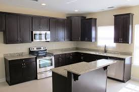 granite countertop kitchen design with dark cabinets tile