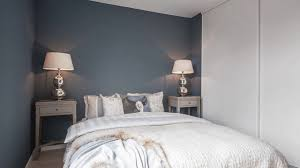beautifully designed one bedroom apartment grey and blue walls