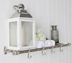 chrome bathroom shelf with hooks for hanging coats bathroom furniture