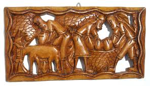 haitian wall carving with local handmade wooden sculptures