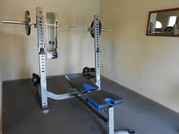 Weight Bench Olympic I Am Looking At A Nautilus Bench Press With A Squat Rack