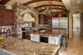 luxury tuscan brick kitchen with solid granite countertop and iron