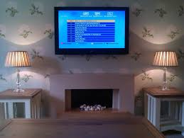 wall mounted tv above fireplace tips to buying a wall mounted tv