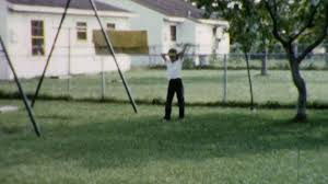 little boythrows backyard baseball suburban 1960s vintage film
