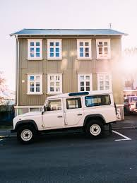 jeep white free images white street house sidewalk roof building jeep