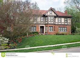 english tudor home with spring flowers stock photo image 90692745