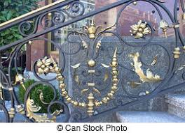 wrought iron fence with gold tips stock photographs search