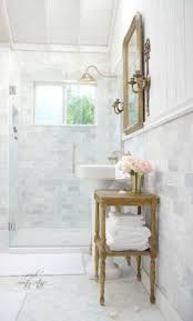 Marble Tile Bathroom Floor Beautiful Bathroom Features A Dark Gray Vanity Topped With Carrera