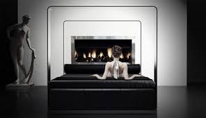 contemporary dark bed design with fireplace in front and white