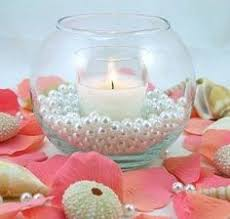 Beach Centerpieces For Wedding Reception by Beachy Centerpieces With Shells Leaves And Candles Helen U0027s