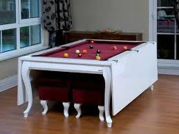 pool table converts to dining table i would want a pool table in our second home if space permits i do