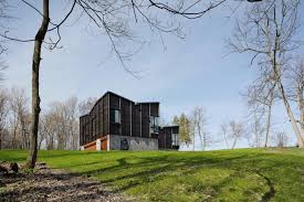 stunning michigan lake house is built from dying ash reclaimed