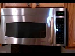 ge spacemaker xl1800 light bulb g e profile microwave oven short demo of the moving vent youtube