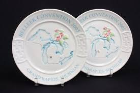 lot of 12 assorted belleek plates and phlet