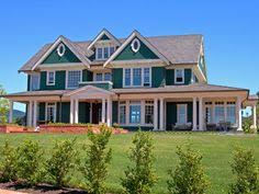 french farmhouse plans how about an opening under the porch with garage on one side and