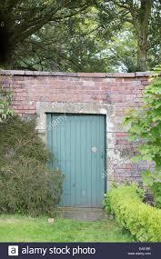 secret garden doorway in wall stock photo royalty free image
