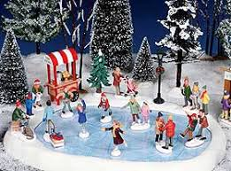 lemax christmas photo showing lemax skating pond in landscaped setting