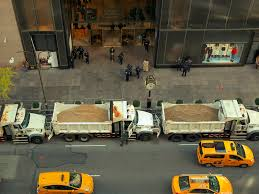 Big Tower Tiny Square by Police Dump Trucks Full Of Sand Protect Times Square New Year U0027s