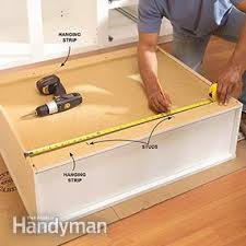 How To Touch Up Wood Cabinets How To Install Kitchen Cabinets Family Handyman