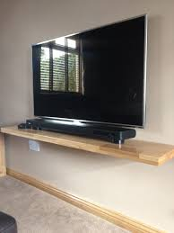 Altus Plus Floating Tv Stand One Of Ours Solid Oak Floating Shelves Used To Support A Flat
