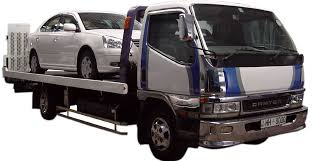 car carrier truck towing and car carrier service to assist immobilised breakdown and