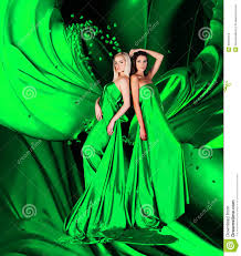 two women in green dress with long hair and hearts royalty free