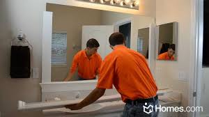 Double Sided Bathroom Mirror by Homes Com Diy Experts Share How To Frame A