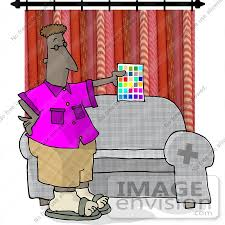 interior designer man holding a sheet of paint color samples in a