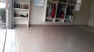 light brown garage floor coating epoxy with wood shoe and helmet