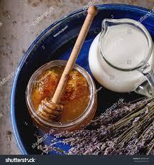 royalty free open glass jar of liquid honey with u2026 380339758 stock