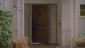 front door video camera soldier wearing uniform opens front door of home and walks towards