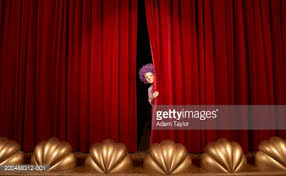 Curtains Show Spotlight On Boy Standing On Stage Curtains Low Angle View Stock