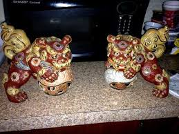 pictures of foo dogs pair of japanese ornate yellow foo dogs lions