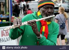 Jamaican Flag Day Flute Player Flutewise Playing In London In Vibrant Rastafarian
