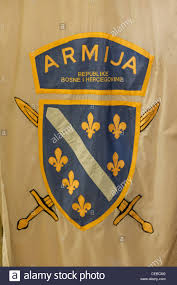 Flag Of Bosnia A Bosnian Army Flag Is Displayed In War Tunnel Museum In Outskirts