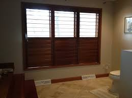 heritage plantation shutters stained perfect view bathroom jpg