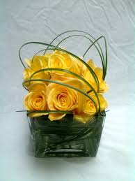 Rectangle Vase Centerpiece Yellow Roses In Short Vase