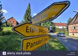 Sign Stands by A Sign Stands Pointing To Greiz Elsterberg And Pansdorf In