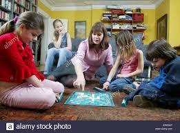 family at home scrabble board united kingdom stock
