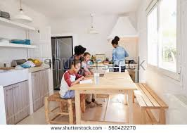 Kids Kitchen Table by Kids Do Homework Kitchen Table Mum Stock Photo 562358437