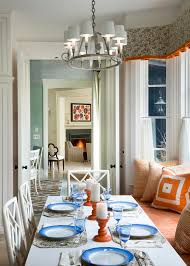 dining table in front of fireplace beautiful window cornice look new york traditional dining room