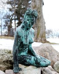 the little mermaid statue on flat river greenville michigan