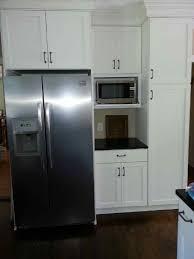 white shaker cabinets with black granite dark wood floors and