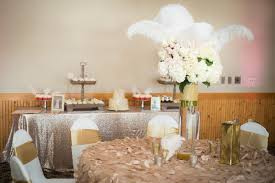 tall white hydrangea centerpiece with white feathers